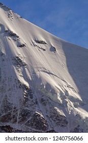 The near vertical knife edge ridge leading to the summit Zinalrothorn, called the Arrete du Blanc. In the southern Swiss Alps