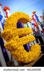 NEARBY KEUKENHOF, NETHERLANDS, APRIL 25, 2015: Artwork of Euro Currency Symbol made of yellow flowers at FLOWER PARADE (Bloemencorso)
