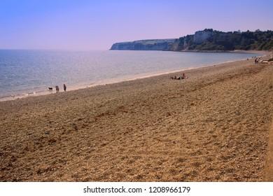 A near-deserted beach at Seaton, Devon, England, UK.