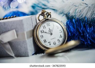Nearly twelve o'clock. New Year's at midnight.