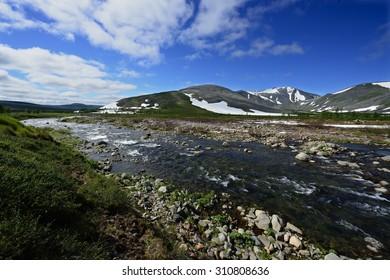 Near-Polar Urals Mountains landscape with a stream river Torgovaya. Research ridge, Komi Republic, Russia