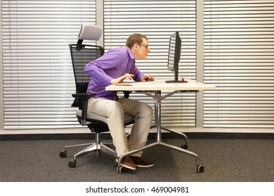 Near-sightedness,  myopia,bad posture Office worker at work station