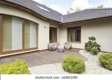 Neat backyard garden in white suburban detached house