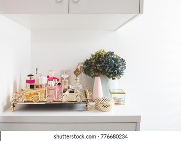 Neat collection of womens fragrance perfume bottles in a dressing room
