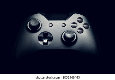 Neat gamepad on black background - close up studio shot