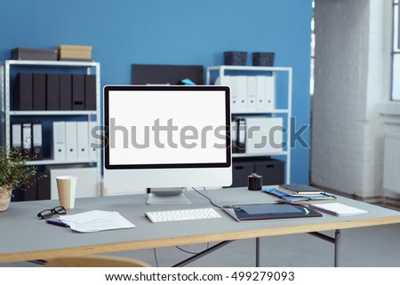 Neat office supplies Table Neat Office Workspace With Blank Screen Desktop Computer Tablet Coffee Spectacles And Chernomorie Neat Office Workspace Blank Screen Desktop Stock Photo edit Now