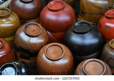A neat stack of small bowls of different earthen colors