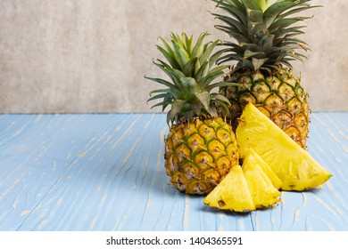 neatly arranged in row with copy space over wooden background in tropical theme