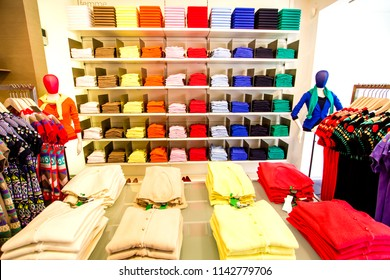 Neatly folded colorful closing in the Parisian fashion boutique