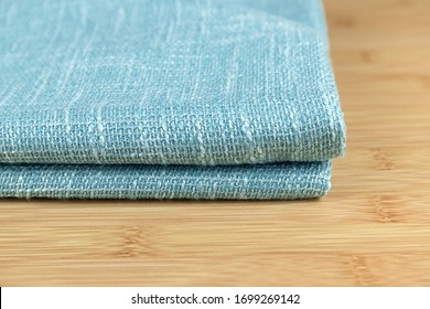 A neatly folded fabric of cotton and linen