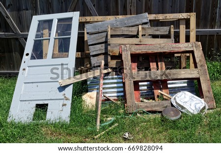 Neatly Piled Backyard Junk.
