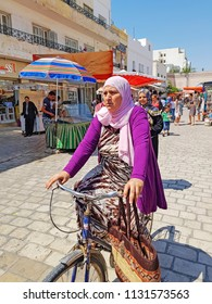 NEBEUL, TUNISIA - JUNE 21, 2018: People in traditional market of Nabeul which offers the wide range of different and colorful goods.