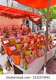 NEBEUL, TUNISIA - JUNE 21, 2018: Market stall selling spices in traditional market of Nabeul which offers the wide range of different and colorful goods.