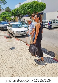 NEBEUL, TUNISIA - JUNE 21, 2018: People walking on the streets of Nabeul which  is a coastal town in north-eastern Tunisia, on  the Cap Bon peninsula.