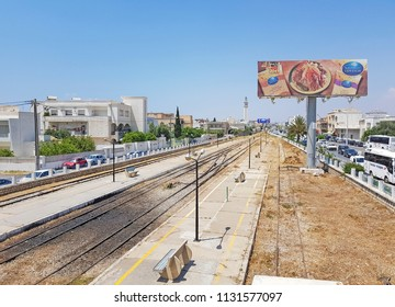 NEBEUL, TUNISIA - JUNE 21, 2018: The railway track running through the centre of Nabeul which is a coastal town in north-eastern Tunisia.