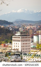 Neboticnik building and Ljubljana old town with mountains as a backdrop in Ljubljana, Slovenia