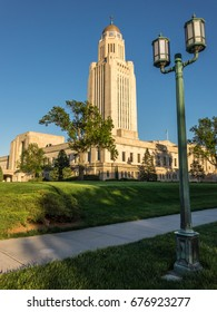 The Nebraska State Capitol in Lincoln at sunset. The office tower is 400 feet tall topped by the 32-foot statue of The Sower, Nebraska State Symbol.