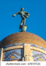 The Nebraska State Capitol in Lincoln is topped by a 20-foot bronze statue called The Sower, sowing seed. Together with its base it stands 32 feet above the 400-foot office tower.