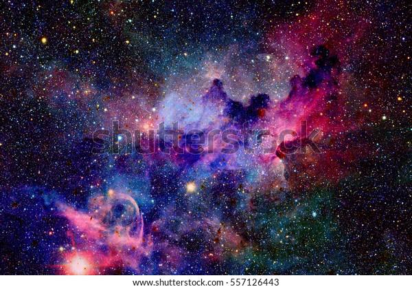 Туманность и галактики в космосе. Элементы этого изображения, оформленные НАСА.