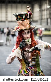 NEC,  BIRMINGHAM, UK - JUNE 2, 2018.  A girl cosplayer dressed as the Mad Hatter from the Alice in Wonderland stories at the Collectormania 25 comic con event in the NEC, Birmingham, UK.