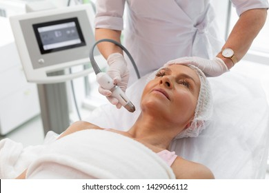 Neck contour. Nice good looking woman having a lifting procedure while correcting the neck contour
