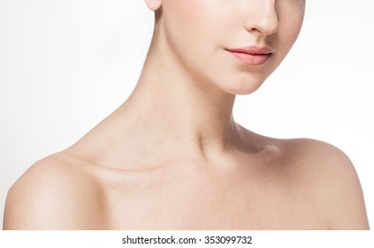 Neck Lips shoulders Beautiful woman face close up portrait young studio on white