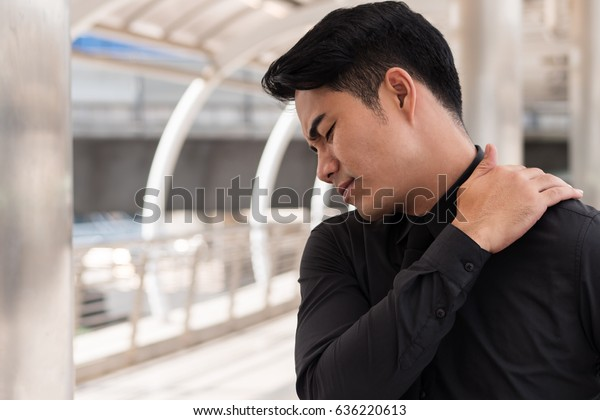 neck muscle pain or stiffness, man model
