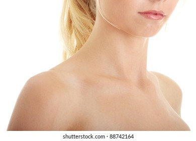 Neck and shoulder of a beautiful girl isolated on white background