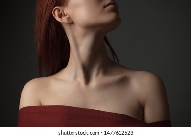 Neck and shoulders of young woman. Studio