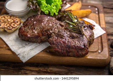 Neck steak, tenderloin or filet mignon pork or beef. Juicy tasty piece of meat. Delicious juicy steak.  A big piece of grilled meat.