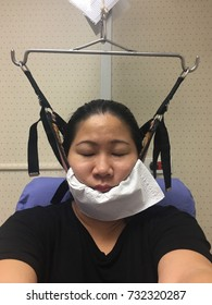 Neck stretching therapy by machine, Cervical traction for neck pain of woman