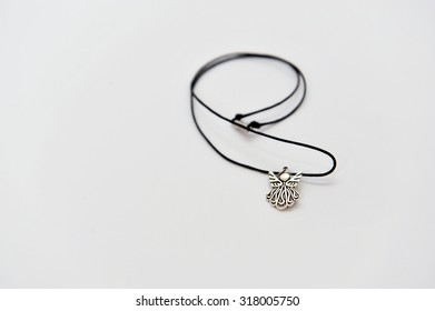 Necklace with an angel, isolated.