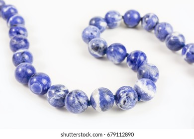 necklace of blue and white semiprecious stone beads