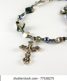 Necklace with crucifix on white background
