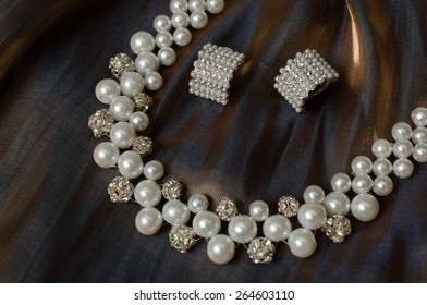 necklace with earrings on cloth