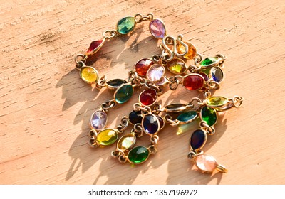 Necklace of gold, adorned with colorful gemstone.  Valuable Jewellery