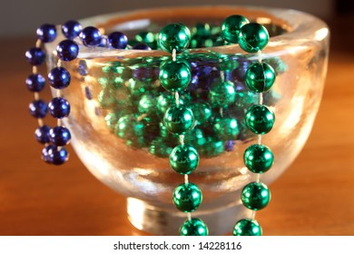Necklace with green and blue pearls in a bowl