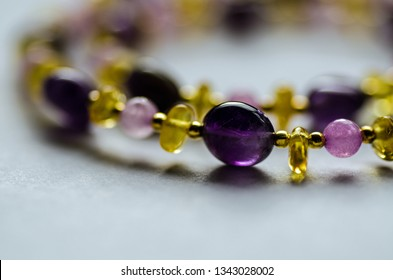 Necklace hand made from amethyst, quartz and amber beads interspersed with gold plated beads.