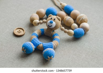 Necklace made from knitted beads and toys for the baby sitting in a sling. Knitted beads. Sling necklace.Vintage teddy bear.Wooden button.