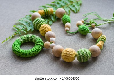Necklace made from knitted beads and toys for the baby sitting in a sling. Knitted beads. Sling necklace.