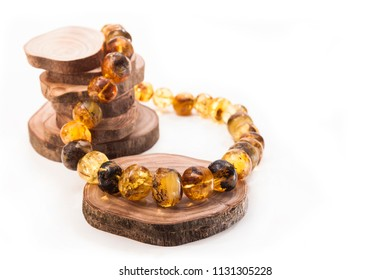 Necklace made of natural large amber on circular sections of a tree
