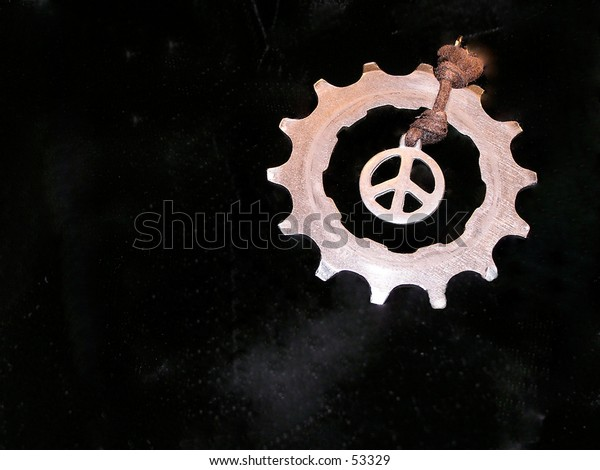 necklace metal hand made with bicycle pieces  - peace stymbol -  black background