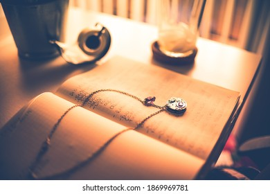 Necklace and Notebook On Business Desk