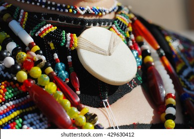 Necklace of old beads and a disc of white shell worn by female Rungus etnicity of Sabah, Borneo, Malaysia.Other than beautiful, beads of Borneo hold social, economic and cultural meaning.