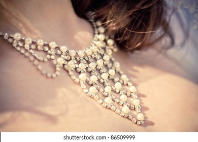 necklace on the neck of bride