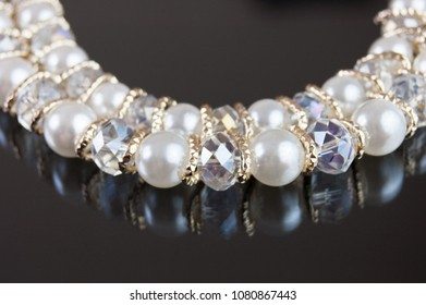 necklace with pearl on black background