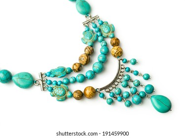 necklace of turquoise and jasper isolated on white