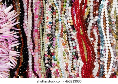 Necklaces in plastic beads