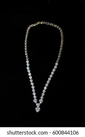 necklaces with precious stones on a black background jewelery