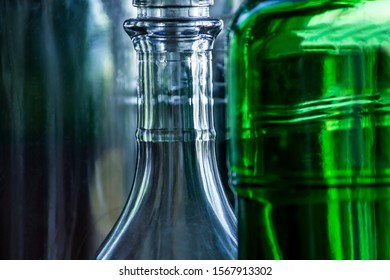 The necks of glass bottles close-up